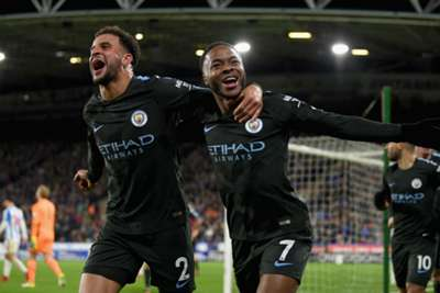 Manchester City maintain 8-point lead with 2-1 win over Huddersfield